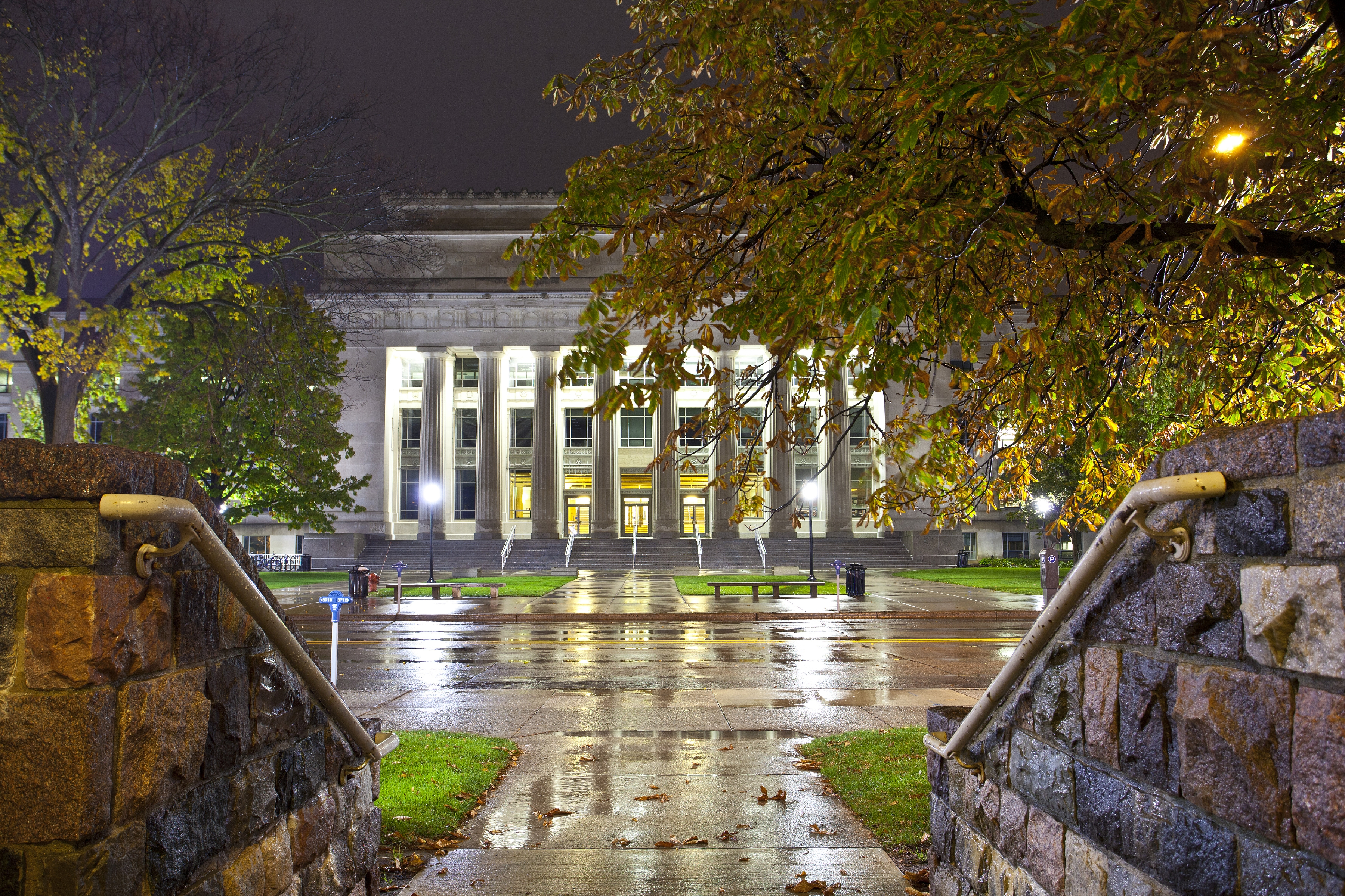 Angell Hall at night after a rainfall