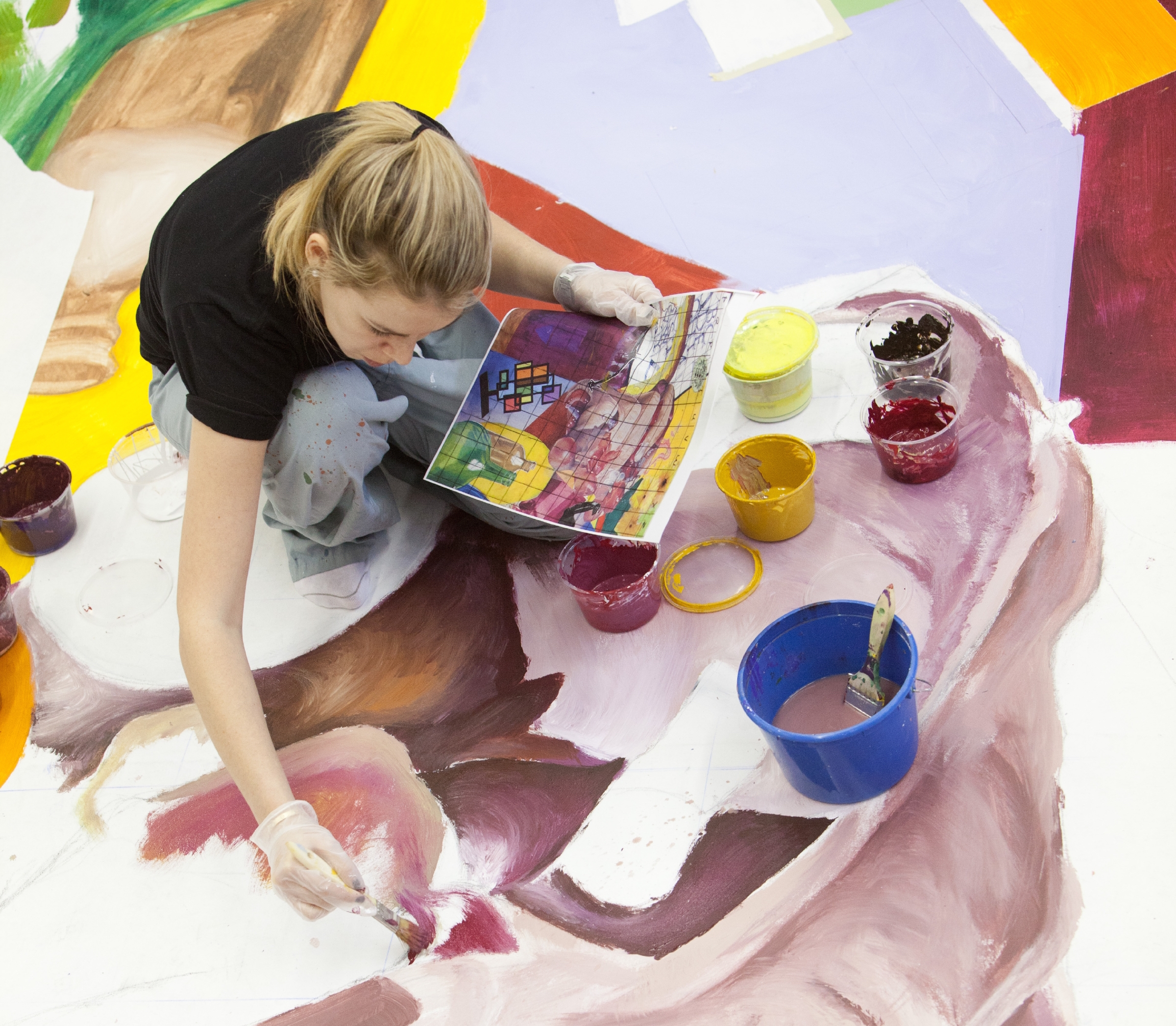 Student painting a large painting