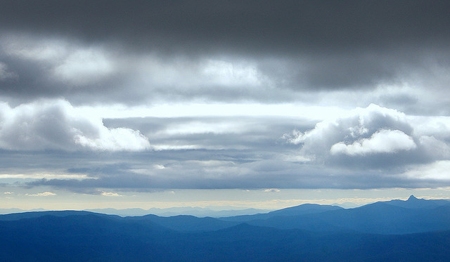 Photo of clouds over blue mountains
