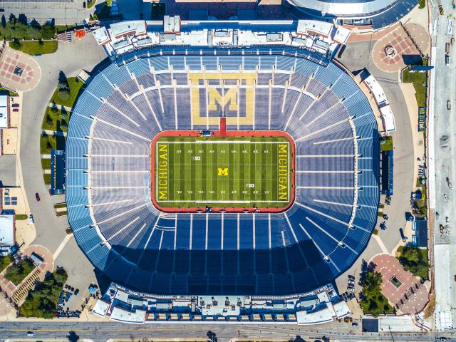 Aerial View of the University of Michigan's football stadium, highlighting the Block M logo on the center of the field.
