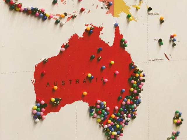 Map of Australia with colorful push pins in different locations