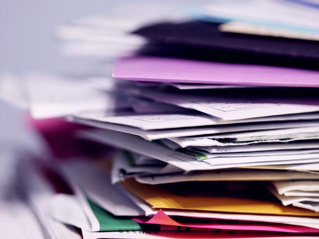 Stack of Paper and colorful Folders