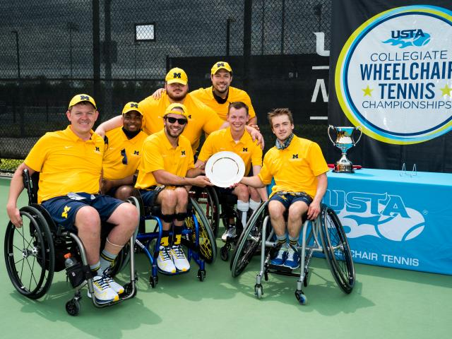 Seven UMich Adaptive Athletes celebrating at the Wheelchair National Championships in Orlando, FL