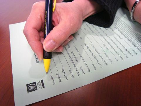 person filling out a form