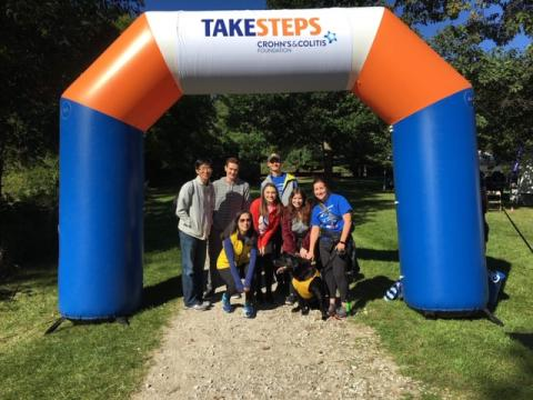 students posing under inflatable banner that reads: take steps crohn's and colitis foundation
